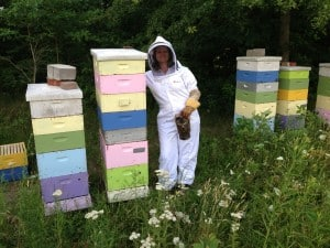 My super awesome beekeeping assistant posing with some of our super crazy bees!