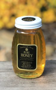 16oz raw honey in glass jar